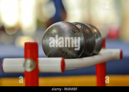 Shot put prepared for competition. Track and Field background. - Stock Photo