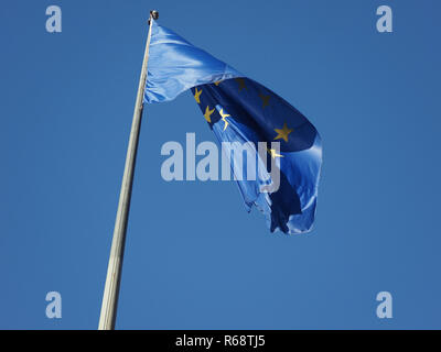 flag of the European Union (EU) over blue sky - Stock Photo