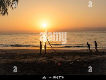 Sunset on the beach, Benguela Province, Benguela, Angola - Stock Photo