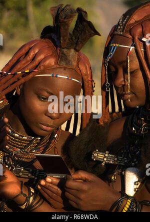Himba tribe young women, Cunene Province, Oncocua, Angola - Stock Photo