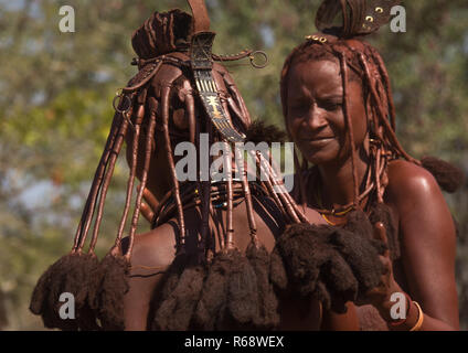 Himba tribe women dancing, Cunene Province, Oncocua, Angola - Stock Photo