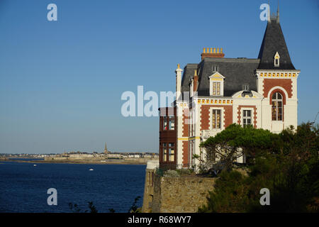 A beautiful old fashion house with a view on the harbor in Brittany, France on a sunny day - Stock Photo
