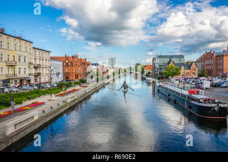 The tightrope walker sculpture in Bydgoszcz - Stock Photo