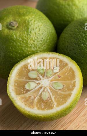 Fresh sour whole and halved  kabosu citrus fruit