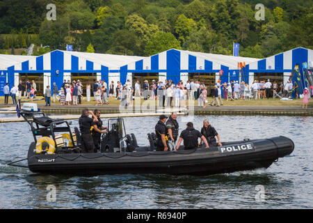 Thames Valley Police patrol the river in their RIB in front of the Boat Tents at Henley Royal Regatta - Stock Photo