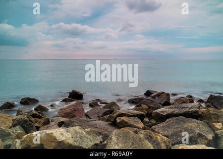 View of Malacca Straits in the evening from Pulau Indah - Stock Photo