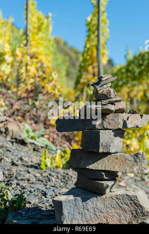 Stone Pyramid On The Edge Of A Vineyard - Stock Photo