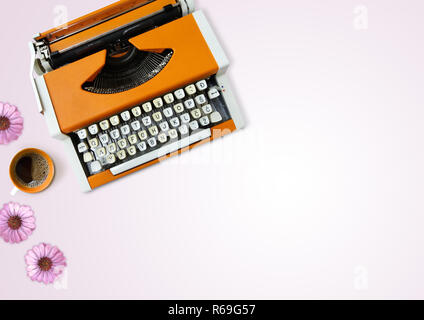 Typewriter, coffee and flowers on light pink background, table top view - Stock Photo