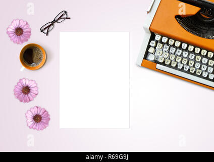 Empty sheet of paper, typing machine, coffee, reading glasses and flowers on light pink background, table top view - Stock Photo