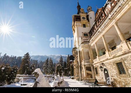 Peles castle in Romania. Beautiful, royal castle in snowy, white winter. - Stock Photo