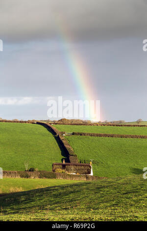 Rainbow over cob and thatch cottage in Dunsford,Devon,country, countryside, pastoral, rustic, bucolic agricultural, farming, agrarian,small house, hou - Stock Photo