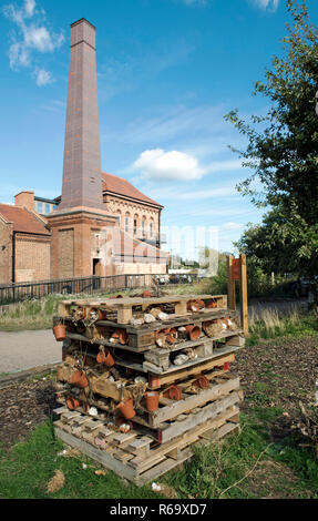Swift Tower and bug hotel two urban habitats together at Walthamstow Wetlands (Formally Walthamstow Reservoirs). - Stock Photo