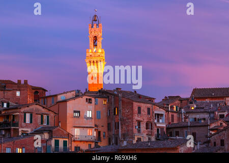 Mangia Tower at gorgeous sunset in Siena, Italy - Stock Photo