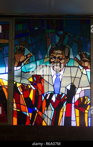 Nelson Mandela is seen depicted as a stained glass window, at a church service for the former South African President at Regina Mundi, Soweto, Sunday, December 8, 2013. The elder statesman died Thursday evening, December 5, 2013. PHOTO: EVA-LOTTA JANSSON - Stock Photo