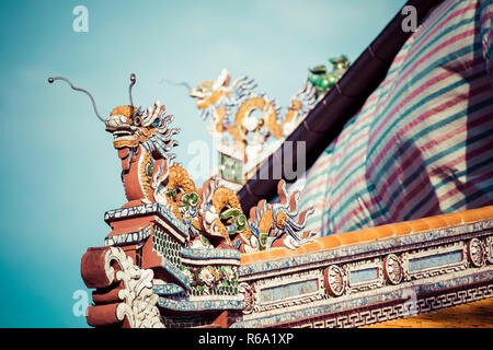 Detailed view of dragons on Citadel the Imperial City with the Purple Forbidden City in Hue, Vietnam. - Stock Photo