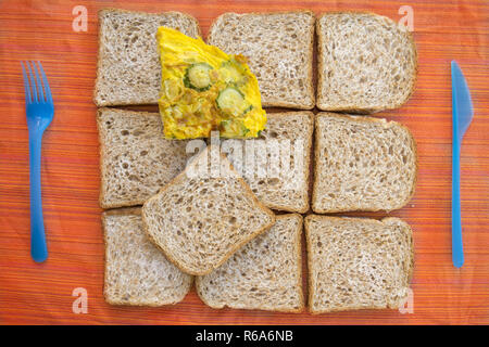 wholemeal sandwich bread and omelette - Stock Photo