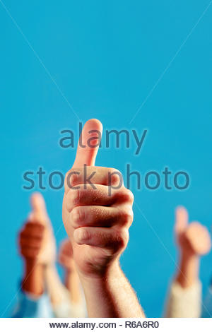 Hands of people holds many thumbs up, great work, congratulates - Stock Photo