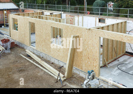 Timber frame house extension or annexe under construction in the UK - Stock Photo