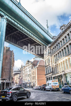 Street view of Side in Newcastle upon Tyne under the Tyne Bridge - Stock Photo