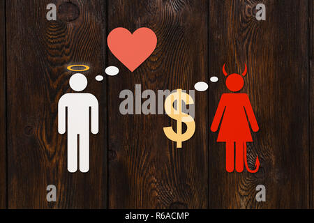 Paper couple, love vs money concept. Angel man and devil woman. Abstract conceptual image - Stock Photo