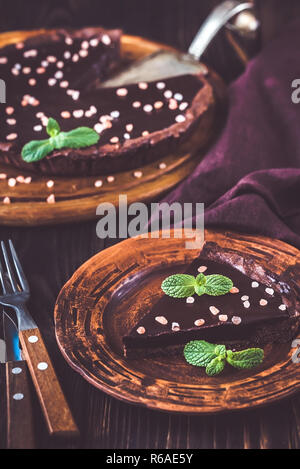 Portion of chocolate salted tart - Stock Photo