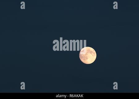 Full Moon Over Dark Blue Night Sky - Stock Photo