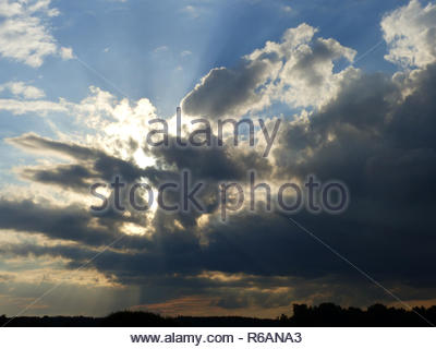 Dark Clouds, And Behind Of Them The Sun Shines - Stock Photo
