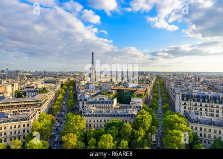 Beautiful view of Paris from the roof of the Triumphal Arch. Champs Elysees and the Eiffel Tower at sunset - Stock Photo