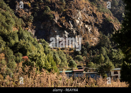 Nepal, Lukla, Chheplung, Rangdo Gompa, rock wall monastery located high on Cliffside at 2660m - Stock Photo