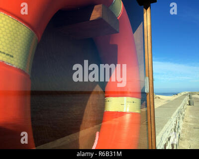 Life Buoy On A Mole Of The Baltic Sea - Stock Photo