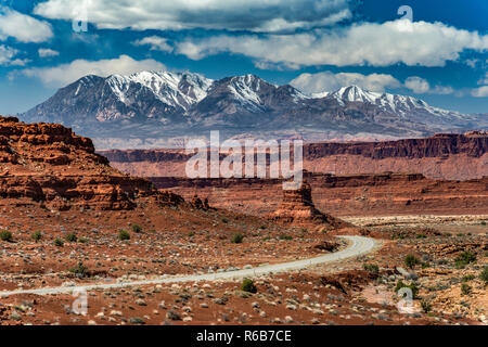 Trachyte Point Plateau cliffs, Henry Mountains in distance, Bicentennial Highway, Glen Canyon National Recreation Area, Colorado Plateau, Utah, USA - Stock Photo
