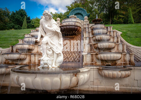 Beautiful fountain on a sunny summer day. Details from Dutch baroque garden with running water, shapes of sea shells and mythological antique white-ma - Stock Photo