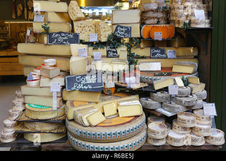 LONDON, UNITED KINGDOM - NOVEMBER 20: Cheese shop in London on NOVEMBER 20, 2013. A variety of cheeses for sale at Borough Market in London, United Ki - Stock Photo