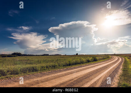 Panoramic image of Cumulonimbus storm clouds over the fields - Stock Photo