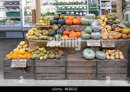 LONDON, UNITED KINGDOM - NOVEMBER 20: Gourds and pumpkins shop in London on NOVEMBER 20, 2013. A variety of pumpkins and squashes for sale at Borough  - Stock Photo