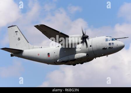 Italian Air Force Aeronautica Militare Alenia C-27J Spartan transport plane flying at the Royal International Air Tattoo, RIAT, RAF Fairford airshow. - Stock Photo