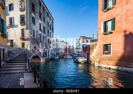 View of side canal and bridges off the Grand Canal in Venice, Italy on 28 November 2018 - Stock Photo