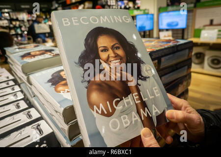 Copies of former Firsts Lady Michelle Obama's book 'Becoming' in an Amazon store in New York on Saturday, December 1, 2018. Obama's book has sold  over 2 million copies in all formats during its forst 15 days making it the best selling book of 2018. (© Richard B. Levine) - Stock Photo