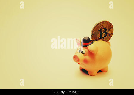 Piggy bank on a toned background, space for text - Stock Photo