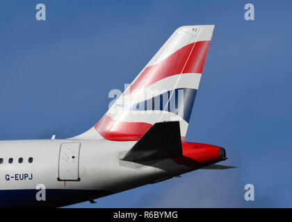 LONDON, ENGLAND - NOVEMBER 2018: Tail fin of a British Airways Airbus jet at London Heathrow Airport. - Stock Photo