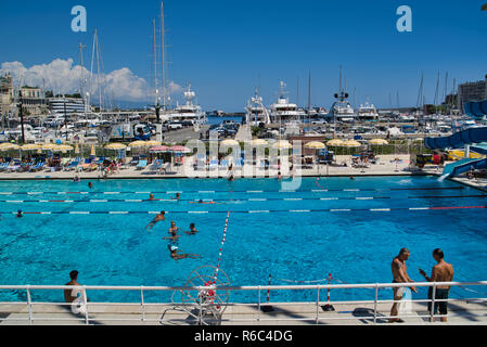 MONACO, EUROPE - AUGUST 11, 2018: swimming center near the Monte-Carlo cruise port - Stock Photo