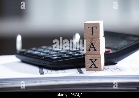 Close-up Of A Tax Text On Wooden Blocks - Stock Photo
