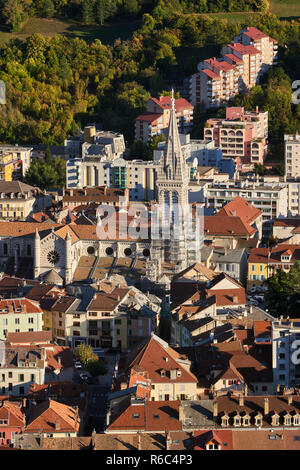 Aerial view at sunset of the rooftops of Gap and the Saint-Arnoux Cathedral. Hautes-Alpes, PACA Region, France - Stock Photo