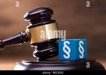 Paragraph Block And Gavel On Judge Soundboard - Stock Photo