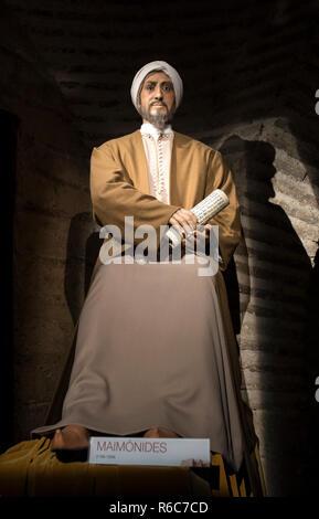 Cordoba, Spain - 2018, Sept 8th: Life-sized sculpture of Maimonides, medieval Sephardic Jewish philosopher. Calahorra Tower Museum, Córdoba, Spain - Stock Photo