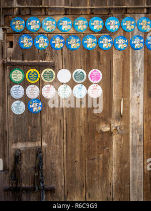 Barn door in Austria with awards for excellent milk quality - Stock Photo