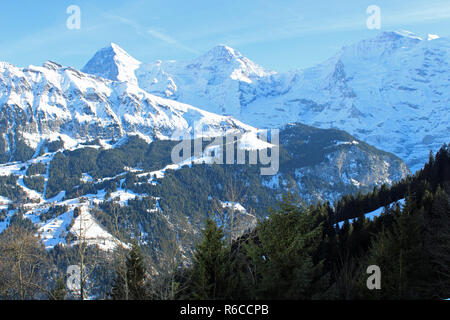 Miles of Winter walking trails nr Murren, Switzerland with view of Lauterbrunnen Valley to Eiger, Monch and Jungfrau mountains and Lauberhorn ski run. - Stock Photo