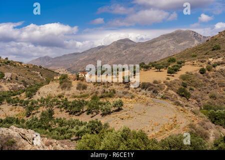 Wide view over the mountain landscape near Preveli beach on the island of Crete, Greece - Stock Photo