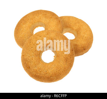 Side view of a three coconut cookies isolated on a white background. - Stock Photo