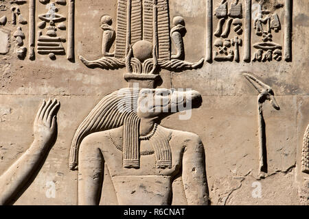 Bas relief images of the Egyptian god, Sobek, represented as a human with a crocodile head, at the Temple of Kom Ombo, Egypt. - Stock Photo